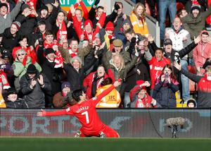 Liverpool's Luis Suarez celebrates scoring against Tottenham Hotspur