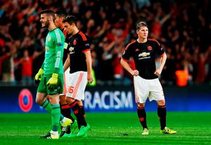 David De Gea, Matteo Darmian and Bastian Schweinsteiger of Manchester United look dejected in defeat after the UEFA Champions League Group B match between PSV Eindhoven and Manchester United