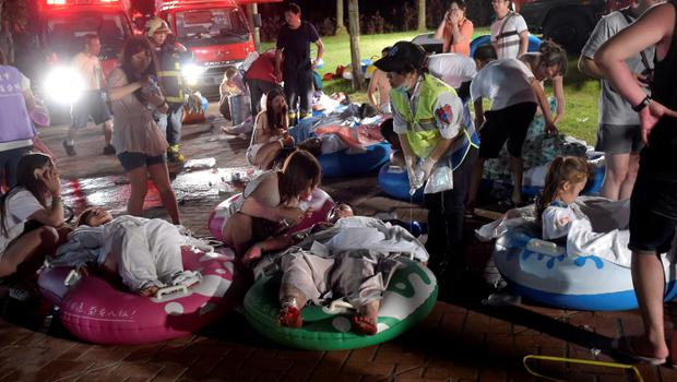 Injured victims from an accidental explosion during a music concert lie on the ground at the Formosa Water Park in New Taipei City, Taiwan REUTERS/Wang Wei