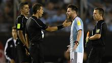 Lionel Messi (2nd-R) argues with second assistant referee Marcelo Vangasse (2nd-L) next to Brazilian referee Sandro Ricci (L) and first assistant referee Emerson Augusto de Carvalho (R)during the half time of their 2018 FIFA World Cup qualifier against Chile. AFP PHOTO / JUAN MABROMATAJUAN MABROMATA/AFP/Getty Images