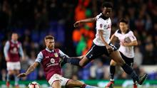 Tottenham Hotspur's Joshua Onomah (right) and Aston Villa's Nathan Baker battle for the ball Picture: PA