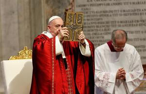 Spiritual guidance: Pope Francis holds the Bible aloft as he leads a Mass in the Blessed Sacrament chapel of St Peter's Basilica at the Vatican. Photo: Remo Casilli/Reuters