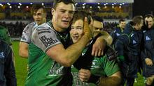 Connacht's Robbie Henshaw, left, and Kieran Marmion celebrate after victory over Munster