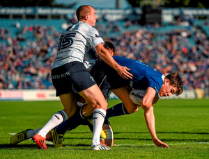 Garry Ringrose, Leinster, is tackled by Dan Fish, left, and Josh Turnbull, Cardiff Blues