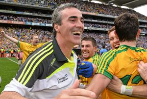 Jim McGuinness celebrates with his players after Donegal's victory against Dublin. Photo: David Maher / SPORTSFILE