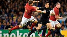 New Zealand's Dan Carter holds off France's Pascal Pape just before his daring reverse pass that had audiences 'oohing and aahing'