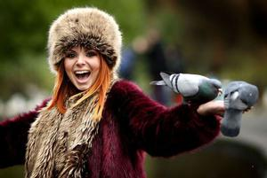 Amanda Dusper originally from Croatia but now living in Dublin finds two hungry pigeons eating from the palm of her hand in St. Stephens Green  Dublin. Gerry Mooney, Independent News & Media