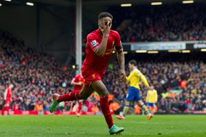 Liverpool's Raheem Sterling celebrates after scoring his second goal against Arsenal during their English Premier League soccer match at Anfield Stadium, Liverpool, England, Saturday Feb. 8, 2014. (AP Photo/Jon Super)