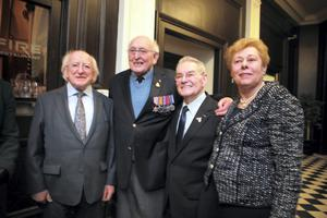 President Michael D Higgins and wife Sabina meets WW2 veteran Albert Sutton and survivors Suzi Diamond and Tomi Reichentalat the Holocaust memorial Day at the Mansion House in Dublin. Picture:Arthur Carron