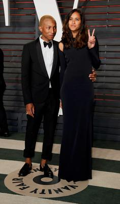 Musician Pharrell Williams and his wife Helen Lasichanh arrive at the Vanity Fair Oscar Party in Beverly Hills, California February 28, 2016.  REUTERS/Danny Moloshok