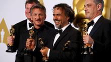 """""""Birdman"""" producer James W. Skotchdopole (L-R), Best Picture presenter Sean Penn, Director Alejandro Inarritu and producer John Lesher pose with the Oscars for Best Director, Best Original Screenplay and Best Picture  at the 87th Academy Awards in Hollywood, California February 22, 2015"""