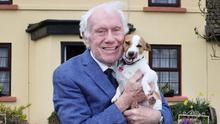 Tom Gunn (82) with his dog Penny at home in Mullingar. Photo: Frank McGrath