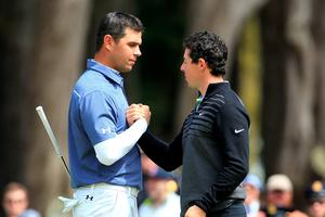 Rory McIlroy shakes hands with Gary Woodland on the 16th hole green after winning their championship match 4&2 in the World Golf Championships Cadillac Match Play at TPC Harding Park in San Francisco, California