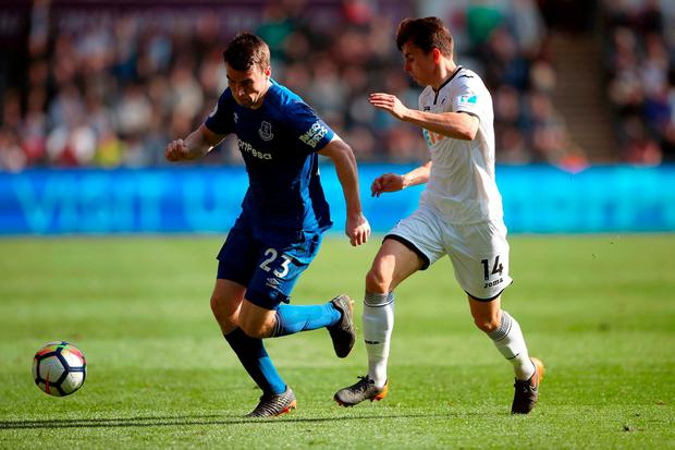 Everton's Seamus Coleman (left) and Swansea City's Tom Carroll. Photo: Nick Potts/PA Wire