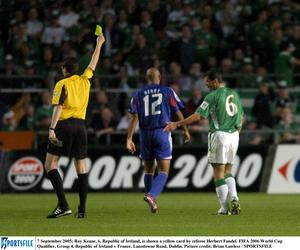 7 September 2005; Roy Keane, 6, Republic of Ireland, is shown a yellow card by referee Herbert Fandel. FIFA 2006 World Cup Qualifier, Group 4, Republic of Ireland v France, Lansdowne Road, Dublin. Picture credit; Brian Lawless / SPORTSFILE