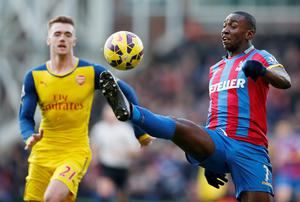 Crystal Palace's Yannick Bolasie in action with Arsenal's Calum Chambers
