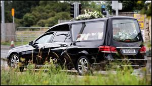 The remains of Daniel Kinahan's mother-in-law Hillary Robinson arrive at Dardistown Cemetery