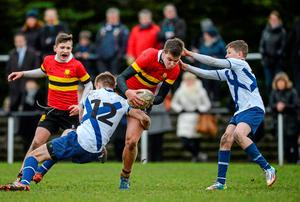 CBC Monkstown's Max Read is tackled by St Andrew's College pair Stephen Kane and Aaron O'Neill during their Fr Godfrey Cup semi-final. Photo: Piaras Ó Mídheach / SPORTSFILE