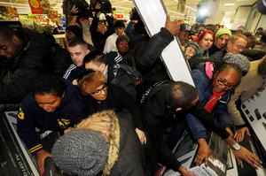 "Shoppers compete to purchase retail items on ""Black Friday"" at an Asda superstore in Wembley, north London November 28, 2014. REUTERS/Luke MacGregor"