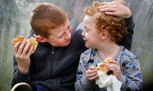 Brothers Cillian and TJ Lynch take a break to enjoy their lunch and each others company at the National Ploughing Championships. Gerry Mooney, Independent News & Media