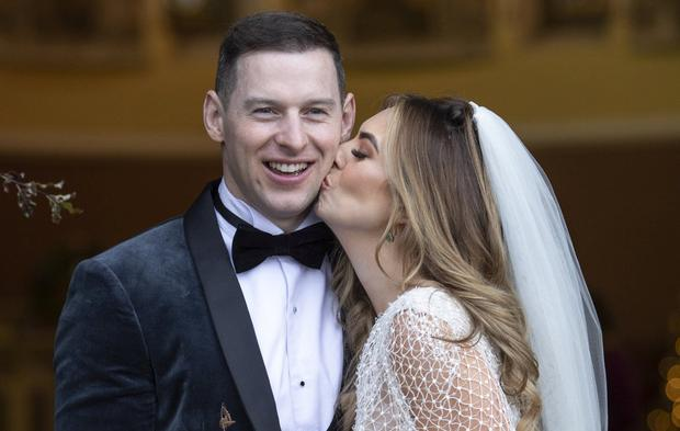 Tender: Sarah kisses new husband Philly McMahon after their wedding. Photo: Fergal Phillips