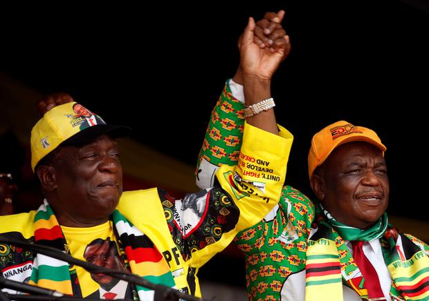 President Emmerson Mnangagwa and his deputy Constantino Chiwenga greet supporters of his ZANU PF party at a rally in Murombedzi, Zimbabwe November 24, 2018. REUTERS/Philimon Bulawayo/File Photo