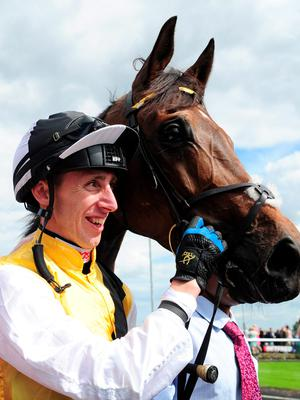 Winning jockey George Baker celebrates with Quest For More after victory in the John Smith's Northumberland Plate