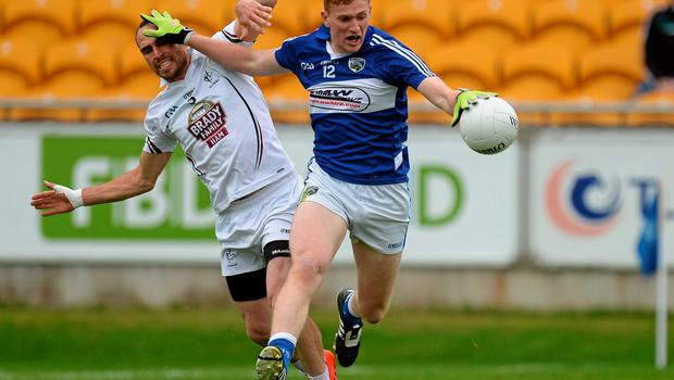Evan O'Carroll, Laois, in action against Kevin Murnaghan, Kildare