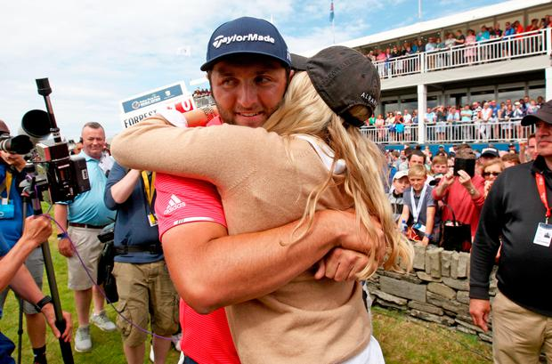 Spain's Jon Rahm, with his girlfriend Kelley Cahill, after he won the 2019 Dubai Duty Free Irish Open at Lahinch Golf Club today. Photo: Donall Farmer/PA Wire