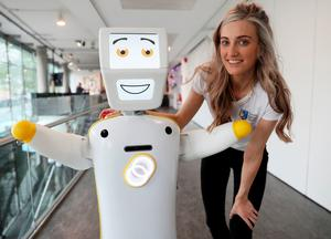 IrelandÕs first socially assistive AI robot 'Stevie II' from robotics engineers at Trinity College Dublin, with Niamh Donnelly, a researcher with the Robotics and Innovation lab, during a special demonstration at the Science Gallery in Dublin. Brian Lawless/PA Wire