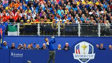 Graeme McDowell of Europe tees off on the 1st hole during the Singles Matches of the 2014 Ryder Cup today.