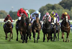 Daniel Tudhope drives G Force (centre) to victory over Gordon Lord Byron (left) with Sole Power (right) back in fourth in Saturday's big sprint at Haydock. Photo: John Giles/PA Wire