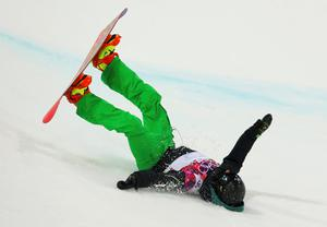 Ireland's Seamus O'Connor crashes out during the men's snowboard halfpipe semi-final event at the 2014 Sochi Winter Olympic Games, in Rosa Khutor February 11, 2014
