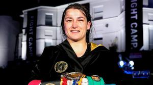 Katie Taylor with her belts after her victory over Delfine Persoon. Photo: Matchroom Boxing via Sportsfile
