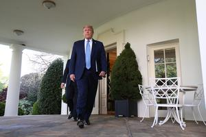 U.S. President Donald Trump leaves the Oval Office to lead the daily coronavirus task force briefing in the Rose Garden at the White House in Washington, U.S., April 15, 2020. REUTERS/Leah Millis