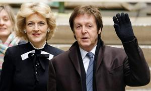 Former Beatle Sir Paul McCartney (R) arrives at London's High Court, on March 17, 2008, with his legal representative Fiona Shackleton.