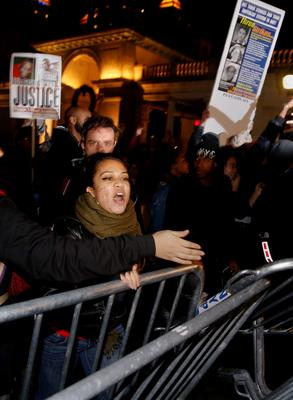 Demonstrators push down New York Police Department (NYPD) barricades during a protest against the verdict announced in the shooting death of unarmed black teenager Michael Brown, at Union Square in New York November 24, 2014. REUTERS/Shannon Stapleton