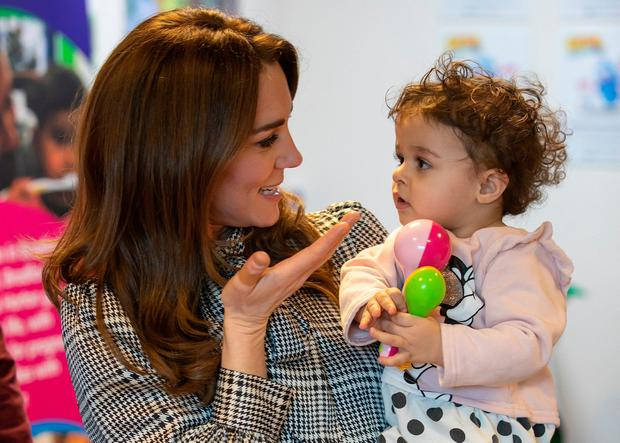 Helping hand: The Duchess of Cambridge with Sorayah Ahmad (18 months) during a visit to a Khidmat centre in Bradford. Photo: Charlotte Graham/PA Wire