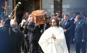 The coffin is carried from The Church of the Immaculate Heart of Mary, Rowlagh after the funeral mass of Keith Walker. Photo: Damien Eagers
