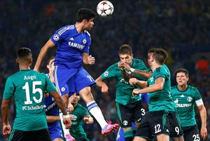 Chelsea striker Diego Costa gets above the Schalke defenders to win heads the ball during the Champions League game at Stamford Bridge. Photo: REUTERS/Andrew Winning