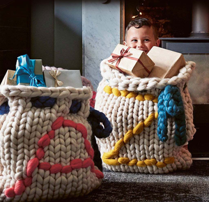 Pack presents in cute hand-knitted sacks like these personalised Chunky Knit Santa Sacks by Lauren Aston Designs from notonthehighstreet.com