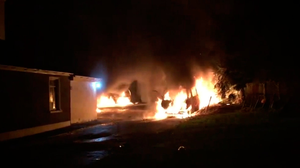 Probe: Cars left ablaze after the attack. Photo: 'The Democrat' newspaper, Roscommon