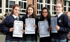 Morgane Daumy,Amber O'Shea,Isha Rughoonauth and Elena Diana Pascariu  after they  received the results of their junior cert examination at Mount Carmel Secondary School,King's Inn Street,Dublin.Pic Tom Burke 10/9/2014