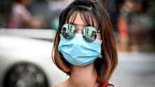 Guideline: The watchdog said it did not recommend wearing facemasks. Picture: AFP/Getty