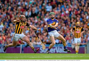 7 September 2014; Eoin Larkin, Kilkenny, loses his hurley trying to block a shot by Noel McGrath, Tipperary. GAA Hurling All Ireland Senior Championship Final, Kilkenny v Tipperary. Croke Park, Dublin. Picture credit: Brendan Moran / SPORTSFILE