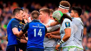 Owen Farrell, centre, confronts Johnny Sexton during their 2018 Champions Cup quarter-final clash at the Aviva. Photo: Brendan Moran/Sportsfile