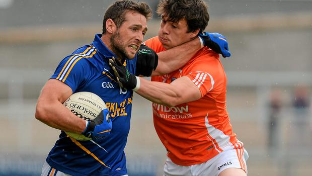 27 June 2015; Paul Cronin, Wicklow, in action against James Morgan, Armagh. GAA Football All-Ireland Senior Championship, Round 1B, Armagh v Wicklow. Athletic Grounds, Armagh. Picture credit: Piaras Ó Mídheach / SPORTSFILE