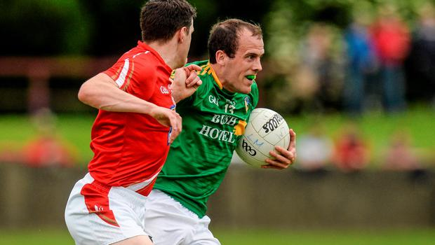 27 June 2015; Fergal Clancy, Leitrim, in action against Adrian Reid, Louth. GAA Football All-Ireland Senior Championship, Round 1B, Louth v Leitrim. County Grounds, Drogheda, Co. Louth. Picture credit: Piaras Ó Mídheach / SPORTSFILE