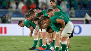 A little respect: Ireland's players take a bow in a show of appreciation for the support they received in Yokohama. Photo by Stu Forster/Getty Images