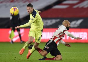 Newcastle United's Fabian Schar in action with Sheffield United's David McGoldrick. Photo: Reuters